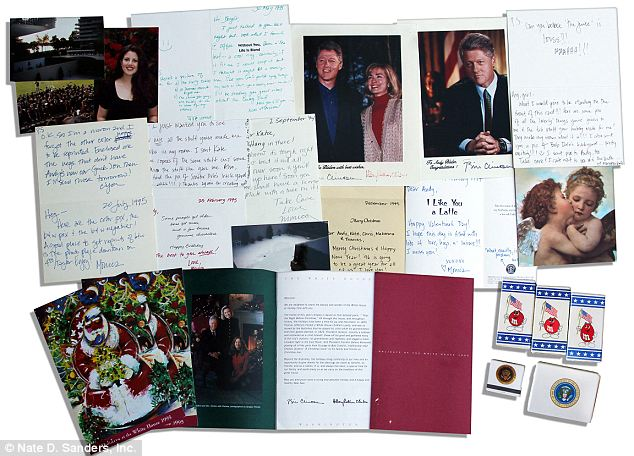 A collection of Monica Lewinsky's old clothes handwritten notes and gifts signed pictures of former President Bill Clinton are now up for sale for thousands of dollars photo