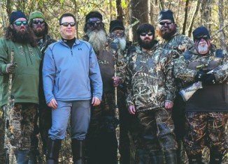 Alan Robertson pictured with his brothers Willie and Jase, father Phil, uncle Si, brother Jeptha and duck call makers Justin Martin and John Godwin
