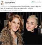 An unknown woman appears in a picture seemingly unknowingly posted from Miley Cyrus's Twitter account