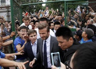 At least seven people have been injured in a stampede in China, which happened when David Beckham arrived at Shanghai Tongji University