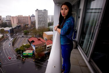 Geraldine Bautista on the 15th floor balcony from which she tried unsuccessfully to save Tom Stilwell who fell 13 floors outside the Volt apartment block in downtown photo