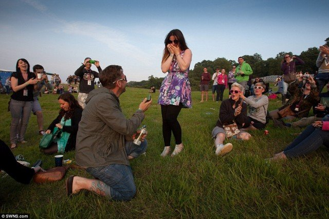 Glastonbury reveller Lee Nickleson gets down on one knee to propose girlfriend Ceilidh Jackson