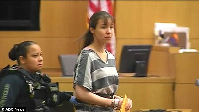Jodi Arias tries the prison stripes and shackles look instead of her skirts and blouses in court appearance photo