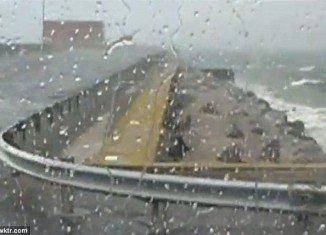 Kent Holcomb was left stranded on the Chesapeake Bay Bridge-Tunnel in Virginia after harsh thunderstorms forced the closure of the bridge