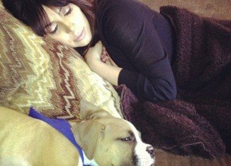 Kim Kardashian has shown up on Khloe's Facebook page looking exhausted and enjoying a nap with boxer pup Bernard