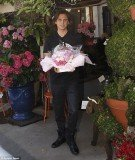 Kim Kardashian's best friend Jonathan Cheban was seen picking up a bouquet of pink peonies and white roses to take to the new mother