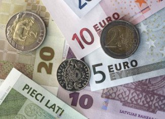 Latvia will become the 18th EU country to use the euro after being approved for membership by the European Commission