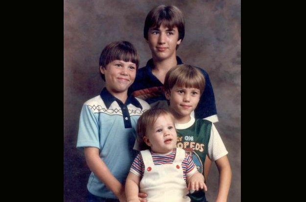 Oldest Robertson brother Alan, who isn't featured on the show, stands over his younger brothers Willie, Jep, and Jase