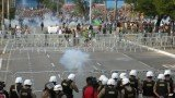 Police have used tear gas to stop protesters from approaching a football stadium during a Brazil-Uruguay Confederations Cup match