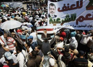 President Mohammed Morsi's supporters and opponents have staged rival rallies across Egypt