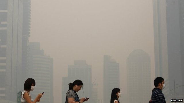 Singapore pollution levels reached a new record high for a third day in a row as smoky haze from fires in Indonesia shrouded the city state photo