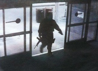 Surveillance footage shows Santa Monica College shooter John Zawahri, entering the campus library, clearly carrying a large firearm