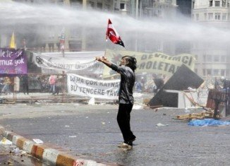 Turkish police clashed with protesters in Istanbul's Taksim Square, despite a warning from PM Recep Tayyip Erdogan