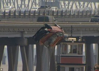 A young woman survived when her car was knocked 40ft off Chesapeake Bay Bridge