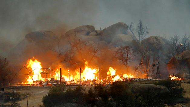 At least 19 firefighters died while fighting the blaze threatening the town of Yarnell about 80 miles north west of Phoenix photo