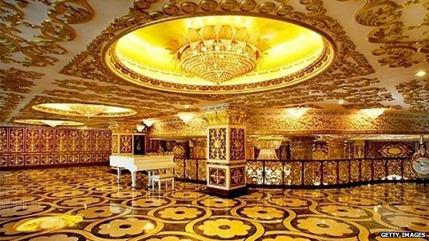Chinese state-owned drug company building decorated to mimic France's Versailles palace, complete with gold-tinted walls and chandeliers