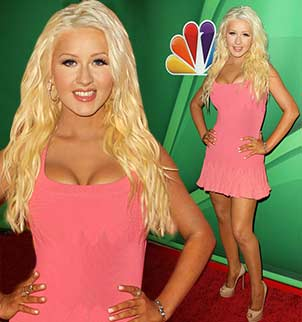Christina Aguilera silenced last year's fat-shaming critics by showcasing her 20 lbs weight loss in a pink mini-dress at a NBC press event in Beverly Hills