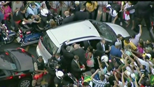 Crowds mobbed Pope Francis' car in Rio de Janeiro as it made its way from the airport