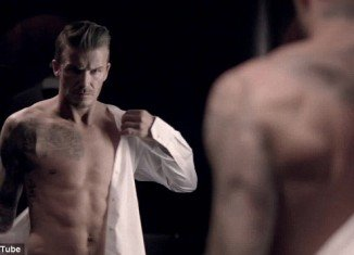 David Beckham reveals his athletic torso in ad for his new fragrance Classic