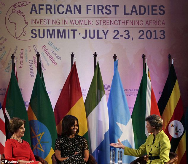 First Ladies Michelle Obama and Laura Bush attended the African First Ladies Summit in Tanzania where they complained about how the White House can feel like a prison photo
