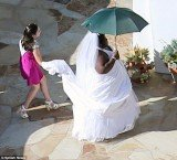 Gabourey Sidibe pranks Jimmy Kimmel as she arrives to his wedding wearing a white dress and veil