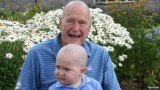 George H.W. Bush has shaved his head to show support for a boy who has leukaemia