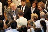 King Juan Carlos of Spain on a visit to the dozens of hospitalized survivors in Santiago de Compostela