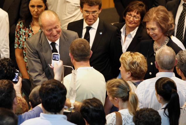 King Juan Carlos of Spain on a visit to the dozens of hospitalized survivors in Santiago de Compostela