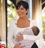 Kris Jenner tweeted a picture of her cradling a dark-haired baby just minutes before her show started
