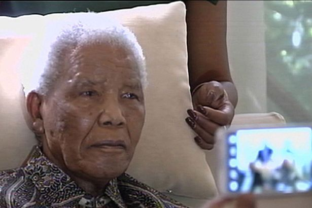Nelson Mandela is being kept alive by a breathing machine and faces impending death photo