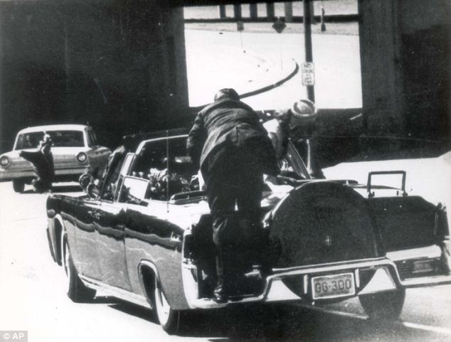 New documentary claims that Secret Service Agent George Hickey riding in the car behind JFK accidentally fired his weapon on November 22 1963 photo