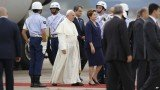 Pope Francis was greeted by Brazilian President Dilma Rousseff at Rio de Janeiro airport