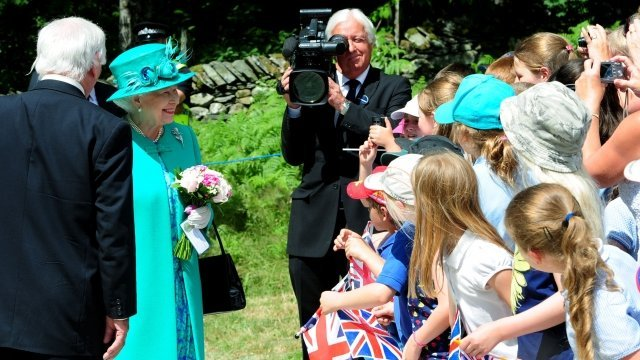 Queen Elizabeth II said she hopes Kate Middleton's baby is born soon, because she is due to go on holiday