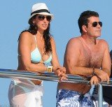 Simon Cowell is expecting a baby with married New York socialite Lauren Silverman
