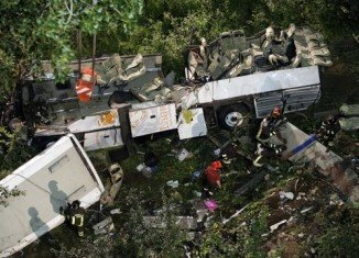 The coach hit several vehicles before smashing through a parapet and toppling down a steep slope near the town of Avellino