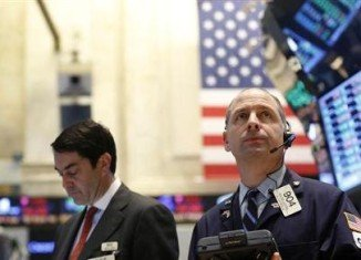US shares closed at record levels after the Federal Reserve indicated that its efforts to boost the economy would continue for now