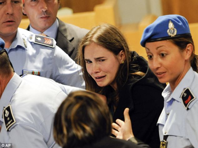 Amanda Knox will not return to Italy for a retrial in the murder of her roommate Meredith Kercher photo