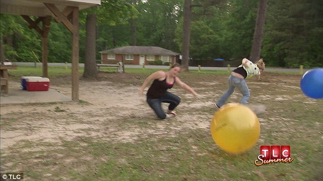"""Anna """"Chickadee"""" and Lauryn """"Pumpkin"""" are seen crashing into each while holding giant balls as Mama June eggs them on and Honey Boo Boo delights in the carnage"""