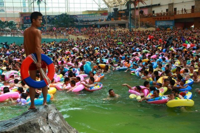 """China's """"Dead Sea"""" is located in Daying county, Sichuan province, and is a riot of color as the masses grab their rubber rings and descend upon it"""