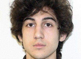 Dzhokhar Tsarnaev was shot through the face, legs and left hand before his capture, according to newly unsealed court documents