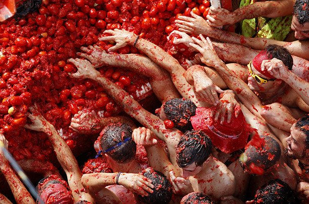 Each year thousands of tourists pack Bunol to take part in the hour long tomato fight that leaves the streets running in red juice photo