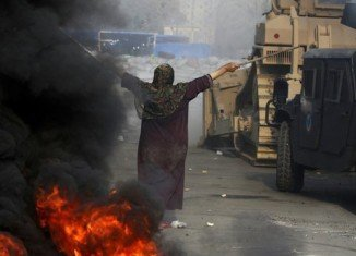 Egypt has declared state of emergency after scores of people were killed when security forces stormed pro-Morsi protest camps in Cairo