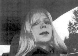 In this undated photo provided by the US Army, Bradley Manning poses wearing a wig and lipstick