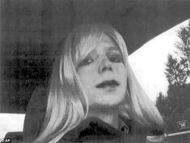 In this undated photo provided by the US Army Bradley Manning poses wearing a wig and lipstick photo