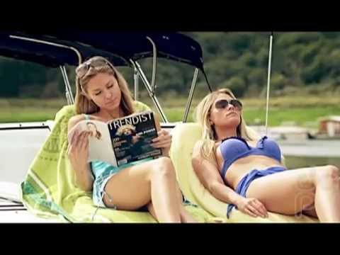 Julie Docherty and Sarah Hester playing in Geico Money Man Boat commercial photo