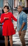 Kanye West proudly shows off a picture of his baby daughter North with Kim Kardashian on Kris Jenner's show