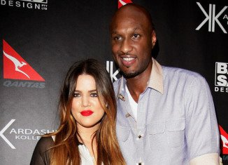 "Khloe Kardashian and Lamar Odom are living apart and have effectively ""split"" after the reality star threw him out of the house"