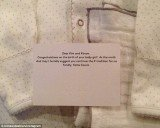 Kim Kardashian uploaded a picture of baby clothes and a note sent by Katie Couric