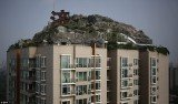 Professor Zhang Lin has spent six years building his dream mountaintop villa on top of a Beijing apartment block