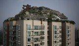 Professor Zhang Lin has spent six years building his dream mountaintop villa on top of a Beijing apartment block